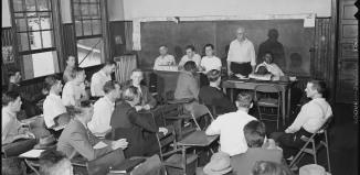 Local_UMWA_union_meeting_is_held_on_Sunday_morning_in_schoolhouse._Inland_Steel_Company_Wheelwright_^1__2_Mines..._-_NARA_-_541440