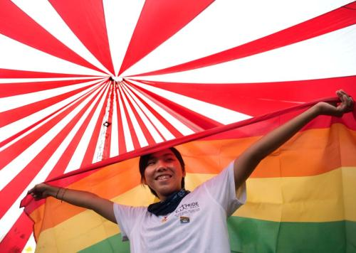482722366-vietnamese-woman-holds-a-rainbow-flag-during-the-fourth.jpg.CROP.promo-xlarge2