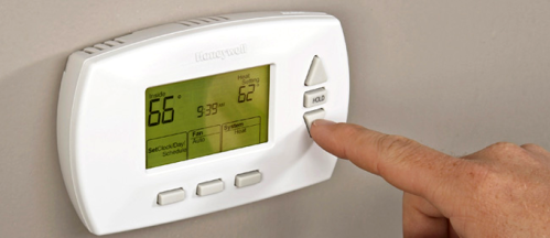 adjusting-thermostat-1